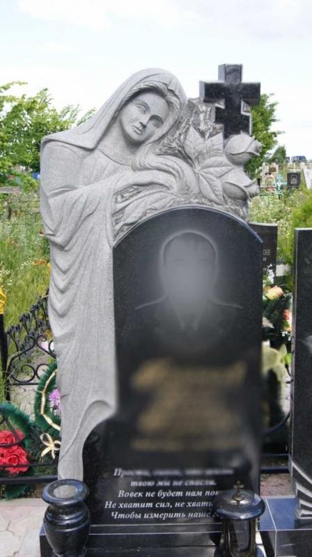 памятник рыбаку на кладбище